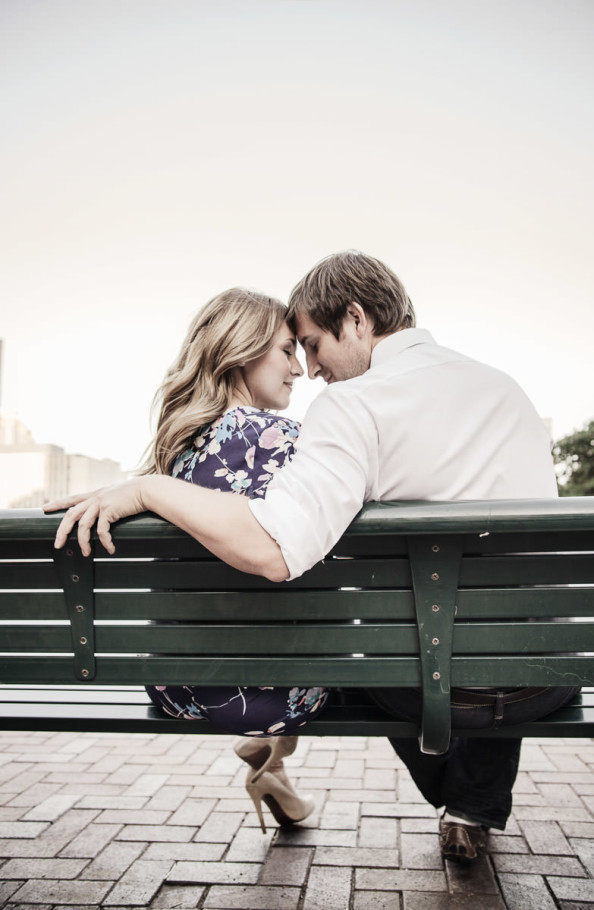 houston downtown engagement portrait on bench by steve lee photography